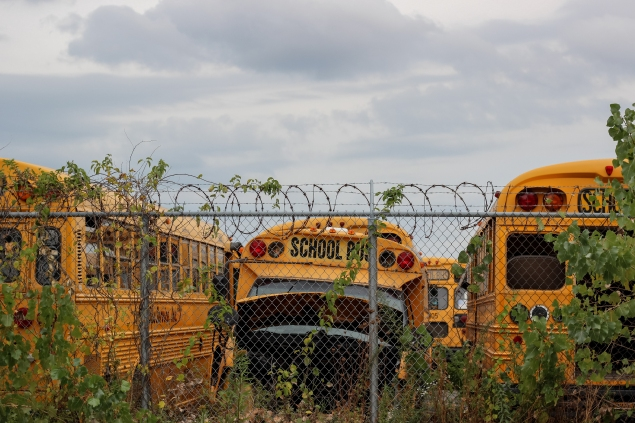 The creepy lot of dead school buses across from our hotel.